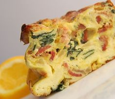 A frittata is round, deep, savory custard that you make for a large group of people. This frittata recipe features spinach, bacon and cheddar cheese.