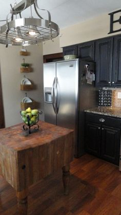 Really great distressed black cabinets and awesome butcher block island!