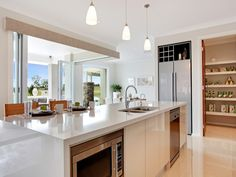 Modern island kitchen design using stainless steel - Kitchen Photo 1311267