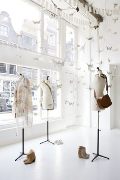 Sukha Amsterdam...http://www.sukha-amsterdam.nl Love the paper birds and empty manequins