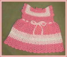 Too cute! A lucky baby girl will look adorable in this Pretty in Pink Toddler Sundress Crochet Pattern.