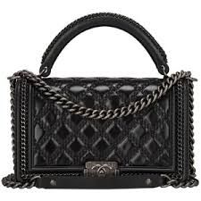 2e0f4fc5edccf0 Preowned Chanel Black Quilted Shiny Goatskin New Medium Boy Bag With Top  Handle