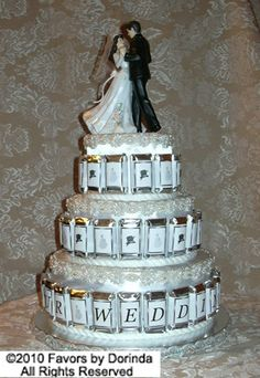 wedding cake surrounded by chocolate candy packs spelling out a special message