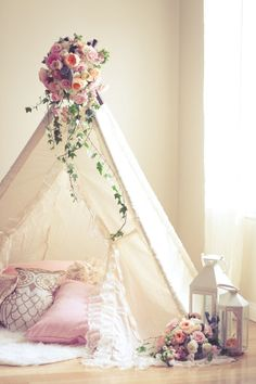 Peg 1 - the teepee for peg 1 will be similar, very girly with lace, ruffles (impractical for real life) but very nice to photograph. We will put flower toppers too (soon to be included in our products - teepee toppers) and leaves that run down the teepee.