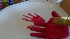"Use ""food-safe"" ceramic paints to decorate keepsake holiday platters (or plates) with your kids' handprints"