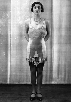 The androgynous silhouette of the 1920s required slick and tight underwear.  http://www.stylist.co.uk/fashion/a-brief-history-of-underwear#item-1