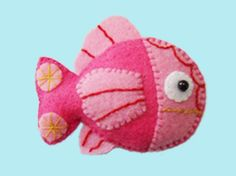 felt fish=darling hair accessory.  You don't need hair- just girlie glue.  It will stay on your baby girl all day!