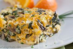 Cheesy spinach and mushroom breakfast casserole is low-carb and high protein. Gluten free and vegetarian., too. Get the recipe on WhatAGirlEats.com
