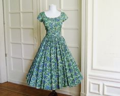 What a wonderfully sweet, springtime delightful floral print 1950s dress. (You can make this with the 1958 Party Dress pattern at sensibility.com.)