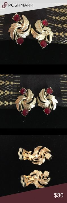 """Vintage Coro Clip Earrings, brushed gold-tone/ruby These  are authentic, vintage signed coral earrings in brushed gold tone  with a faceted ruby colored stones. No idea how much they cost in the 1950s.  They are dazzlingly beautiful and would complement any occasion.  The earrings are in excellent condition and have a paddle back clip.    The back of each clip is stamped """"Coro""""  Circa 1950s.  The earrings measure 1"""" x 3/4"""". Coro Jewelry Earrings"""