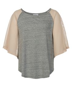 grey top with pretty sheer sleeves. Still gives you the feeling of something on your shoulders without being a whole sleeve