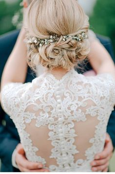 wedding updo hairstyles with flowers for long hair brides