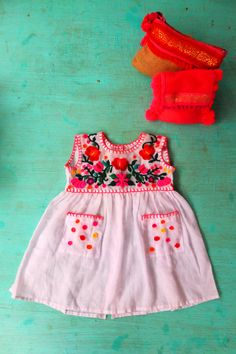 Embroidery Baby Dress by Flora de Chazal.