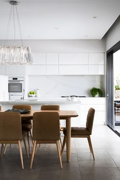 Swann Rd by Matthew Barnes Interior Design | Dining area featuring Arthur G Reuben Chairs | Queensland Homes | www.arthurg.com.au/range | Melbourne | Sydney | Perth | Australian Made
