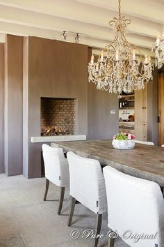 Stunning dining room chandelier and love the raised to dining level fireplace