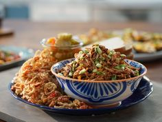 Slow-Cooker Pulled Pork with Fried Shallots and Chiles recipe from Valerie Bertinelli via Food Network