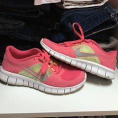Pink nike free runs Size 6.5 in youth but fits as a size 8 in women's. Wore them a few times in an indoor gym. Only mark is the blue smudge on heel of sneaker. Make an offer :) Nike Shoes Athletic Shoes