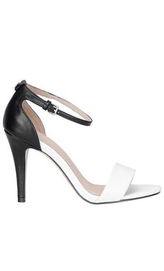 Simple yet stunning, this two tone leather high heels in black and white would look cute with a pencil skirt as well as jeans. #fashion