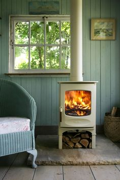 turquoise room with white wood stove