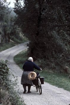 'Woman with bicycle and bread - 'Dordogne, 1977', Jean Gaumy