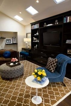 Black entertainment center and that amazing teal chair!!!!!!!!