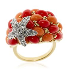 Kenneth Jay Lane, gold, element in resin color coral, a star crystal.