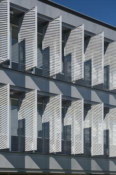 M2 Technological Building, University of Salamanca / Sanchez Gil Arquitectos, west facing rotating vertical sun shades, perforated metal sunshade, expanded metal sunscreen