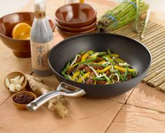 """Spice up your routine with the Contemporary Nonstick 12"""" Flat Bottom Wok- great for dinner ideas like a Stir Fry, Seasoned Vegetables or Pad Thai!"""