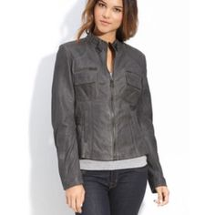 """Bod & Christensen Grey Leather Jacket Bod & Christensen Grey Leather Jacket: price is negotiable!!! Soft, lustrous leather shapes a sleek jacket detailed with gleaming zippers and buckled snap tabs to cinch the waist sides. Front zip closure. Buckle tabs at collar. Front pockets with hidden snap closure; zip chest pockets over snap-flap chest pockets. Zip cuffs. Approx. length from shoulder: 23"""". Leather; professional leather clean. Bod & Christensen Jackets & Coats"""