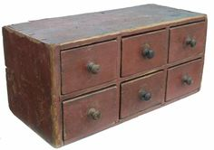 "Early 19th century Pennslyvania Apothecary Spice Chest with six drawers, all original mushroom turned knobs, dovetailed case and drawers, in original dry red paint. circa 1800 -1820 17 1/2"" wide x 8"" tall x 8"" deep - from Country Treasures Antiques"