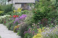 great dixter gardens with a pop of hot color