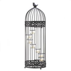 I have never seen a birdcage as a candle holder. This would look perfect on my coffee table. I love how quirky it is.