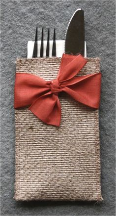 Our hand-tied ribbon silverware pouch adds festivity to any table decor. We love…