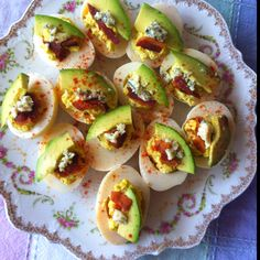 Easter snack: deviled eggs with avocado, bacon, blue cheese and paprika.