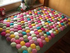 I will NOT be making this, but it's still pretty interesting. Each hexagon is knit separately and stuffed, and then they are all sewn together to make a pillow, throw, rug, etc.