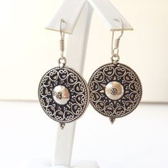 Sterling Silver Boho Dangle earrings Very cool Boho genuine Sterling Silver dangle earrings on a French hook. The Sterling Silver disks have an intricate design on them. They are stamped 925 (Sterling silver) on the back. Jewelry Earrings