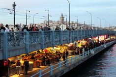 Image of 'Bridge full of restaurants and fishermen, #Istanbul'
