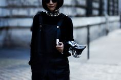 PFW Street Style: Yoyo Cao wearing a studded turtleneck by Alexander Wang, leather overalls and leather bag by J.W Anderson in Paris, France