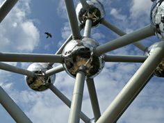 Linda DV posted a photo:  Brussels, Belgium.  The Atomium is a building in Brussels originally constructed for Expo 58, the 1958 Brussels World's Fair. Designed by the engineer André Waterkeyn and architects André and Jean Polak, it stands 102 m (335 ft) tall. Its nine 18 m (60 ft) diameter stainless steel clad spheres are connected so that the whole forms the shape of a unit cell of an iron crystal magnified 165 billion times. It is now a museum.  Tubes of 3 m (10 ft) diameter connect the…