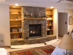 hearth extends in front of bookcases