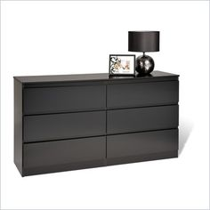 Prepac Avanti Six Drawer Dresser in Black - The Avanti Bedroom Collection has an elegant, contemporary design that will add a level of sophistication to any bedroom. In place of hardware, the top of each drawer front is rounded to ease opening. When combined with Avanti's straight lines, this creates a clean, uncluttered appearance. Each piece is constructed from CARB compliant composite wood with an attractive and durable dark laminate finish. Drawers have solid wood sides that run on metal…