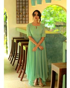 Beautiful georgette and silk Kurti with asymetric cut and gota work embellishments. Plain Kurti Designs, Silk Kurti Designs, Salwar Neck Designs, Churidar Designs, Kurta Designs Women, Kurti Designs Party Wear, Kerala Saree Blouse Designs, Frocks And Gowns, Dress Indian Style