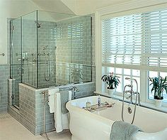 love the seafoam tile and the clawfoot tub :) Light and relaxing bathroom :)