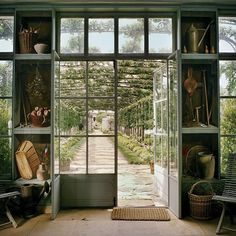 """Another inspirational shot of Bunny Mellon's gardens, which Country Life described as """"studies in composition, simplicity, restraint and beauty."""" You could say the same of these stellar trompe l'oeil murals by Fernand Renard on the walls of her garden shed. . #interiordesign  #decorativepainting #interior #surfacedesign #interiordecor #interiorstyle #interiordesignideas #decor #interiorarchitecture #countrylife #fernandrenard #newyorker #vanityfair #bunnymellon"""