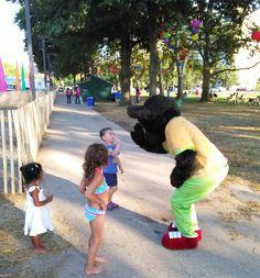 Prada Enchilada greets kids in the park.