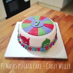 This PJ Masks cake is also a piñata full for smarties - happy 7th birthday! Cakey Weller