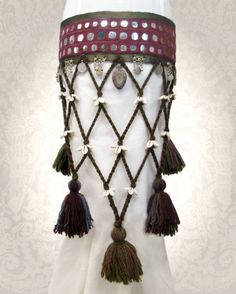 Not sure I'd want to embroider that many shisha, but I like the shells as spacers.  Netting would have to be from standard yarn, but maybe handspun for tassels?