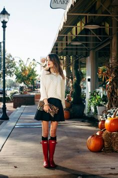 Taylor Morgan matches her lippie to her Boots with this perfectly put together look. The leopard print clutch adds the unexpected splash of texture to this black skirt and chunky cable knit sweater combo. Skirt: Topshop, Clutch: Clare V, Boots: Hunter, Lipstick: Mac