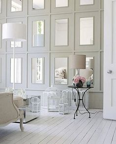 Add architectural moulding and mirrors to south window wall. P.s. No birdcages I promise ;)