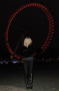 Sienna Miller braved the cold in honor of World Aids Day in London when she helped turn the London Eye red.